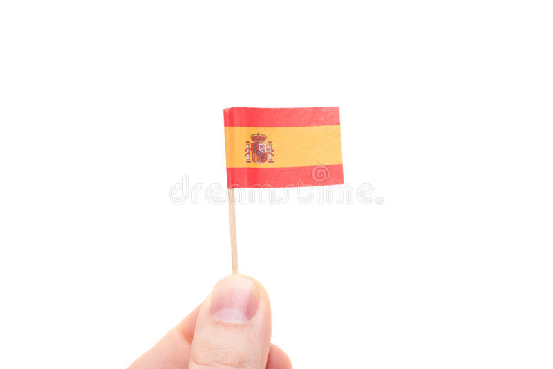 Hand, die spanische Flagge hält lizenzfreie stockfotos
