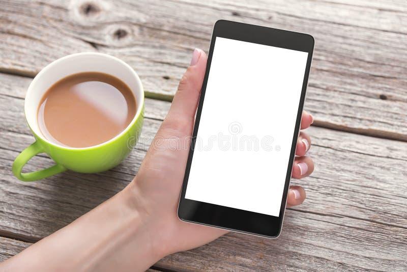 Hand die telefoon met het lege scherm met behulp van stock afbeelding