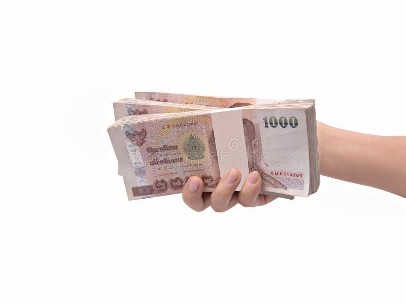 Hand die Thaise bankbiljetten geven stock foto