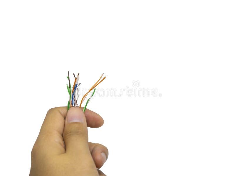 Hand, die unordentlichen farbigen Kupferdraht auf lokalisiertem weißem Hintergrund hält lizenzfreies stockfoto