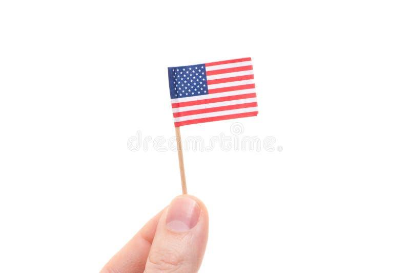 Hand, die US-Flagge hält stockfotografie