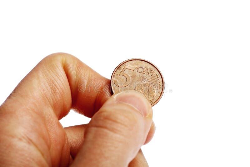 Hand die vijf eurocentmuntstuk houden royalty-vrije stock fotografie