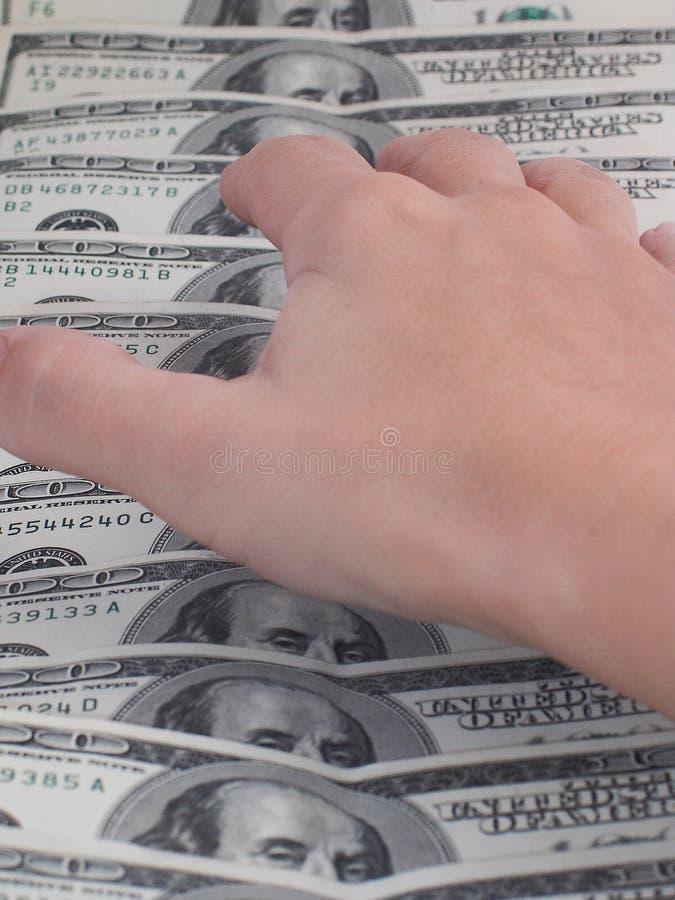 Hand die voor geld bereikt royalty-vrije stock foto