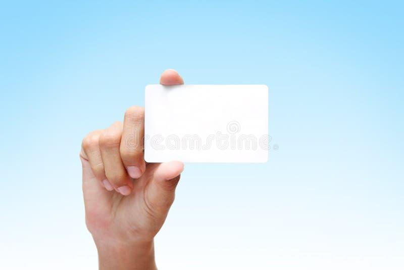 Hand die wit adreskaartje houdt royalty-vrije stock foto's
