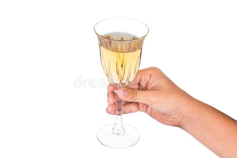 Hand die witte wijn in kristalglas houden en klaar te roosteren stock afbeeldingen