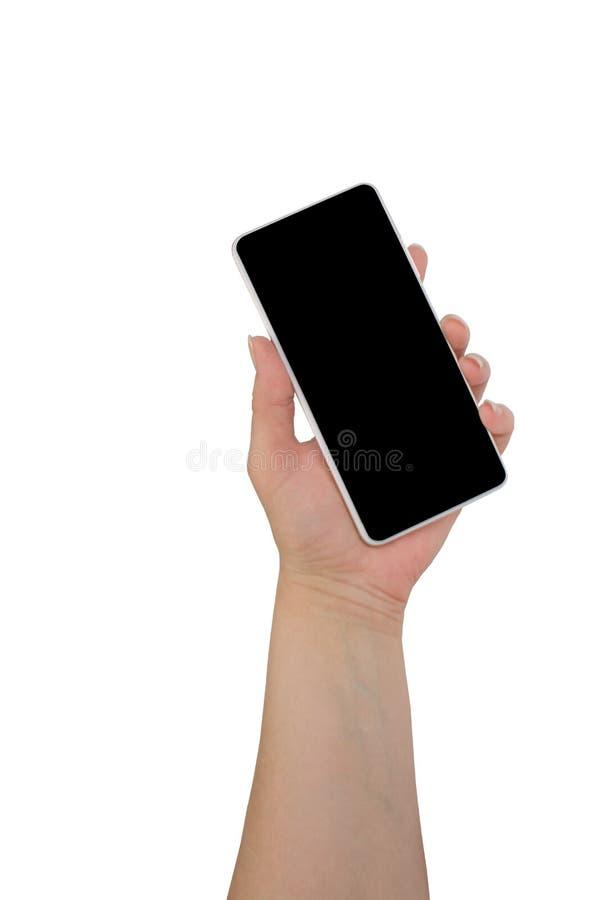 Hand die zwarte die telefoon houden op witte het knippen weg binnen wordt ge?soleerd stock foto's
