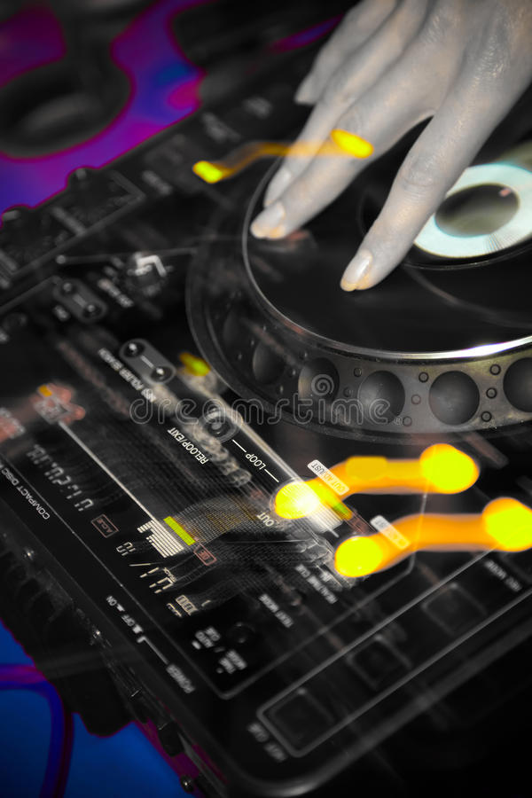 Hand of a DJ on a turntable in a nightclub royalty free stock image