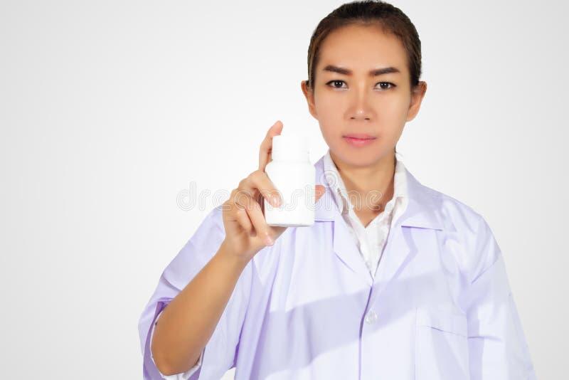 Hand of doctor holding medicine bottle on white background stock photos