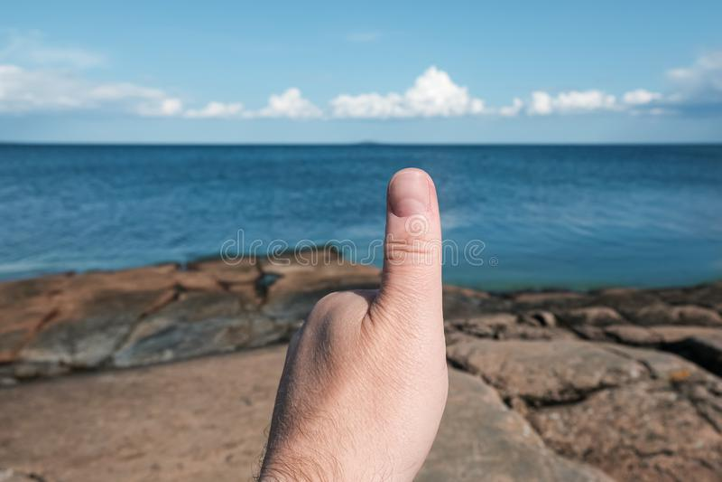Thunbs Up on Baltic Sea Coastline stock image