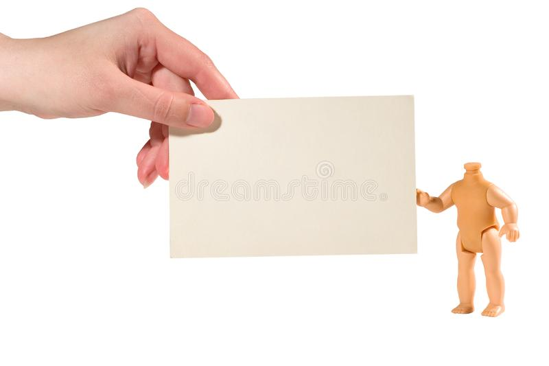 Hand and a doll holding together a paper card stock photo