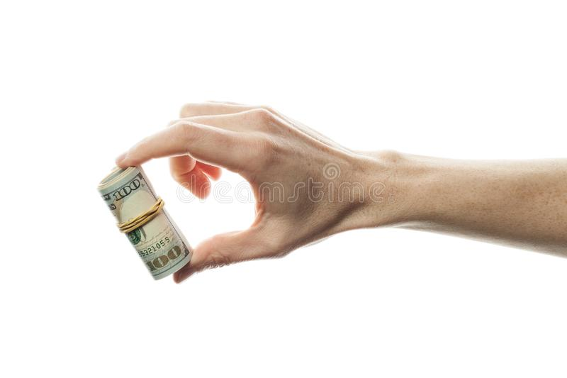 Hand with dollars cash money isolated on white background. US Dollars 100 banknote.  royalty free stock photos