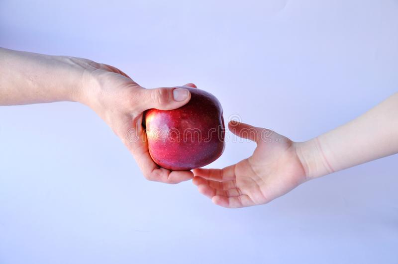 Hand door and red apple royalty free stock photos