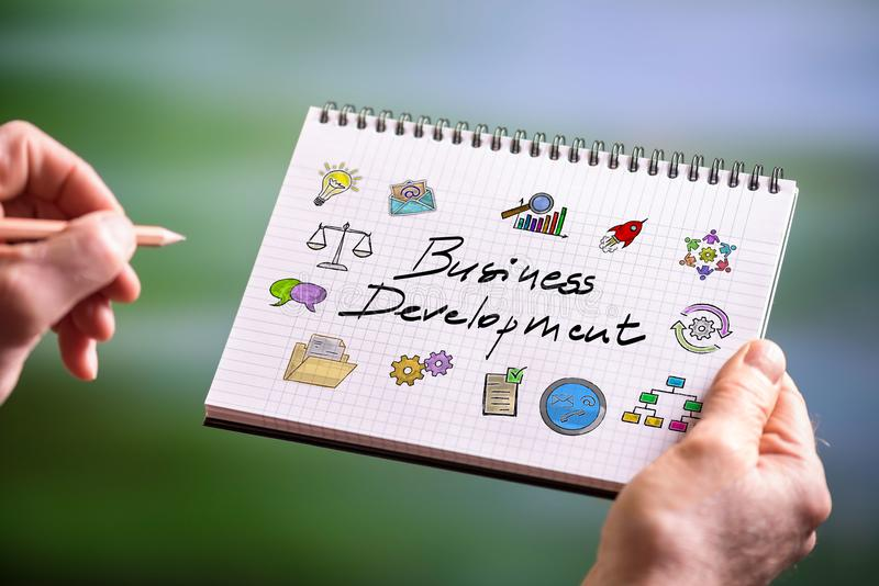Business development concept on a notepad. Hand drawing business development concept on a notepad stock photos