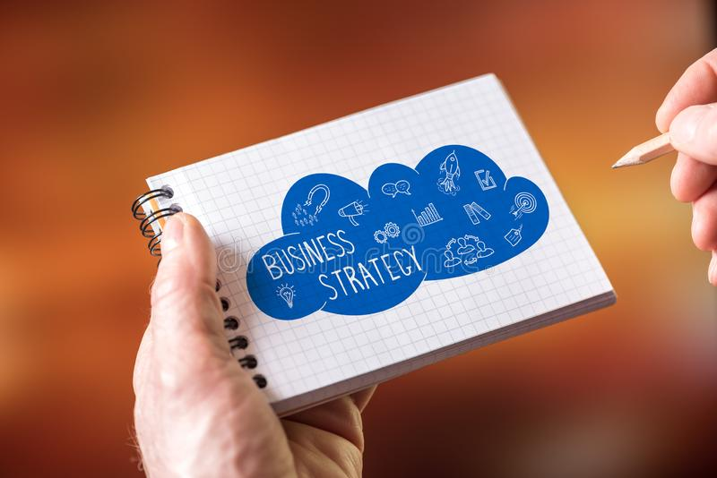 Business strategy concept on a notepad. Hand drawing business strategy concept on a notepad stock photography