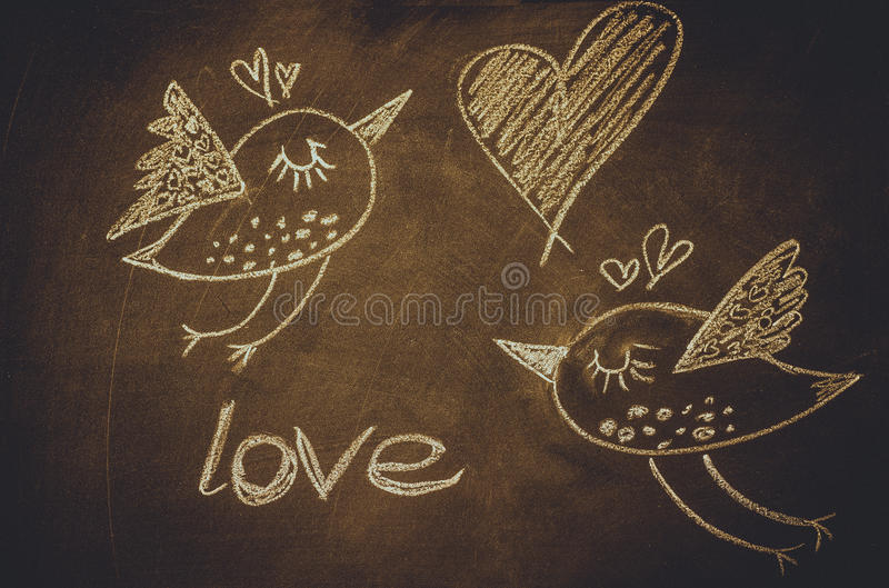 hand drawing with chalk on blackboard cute kawaii birds heart and