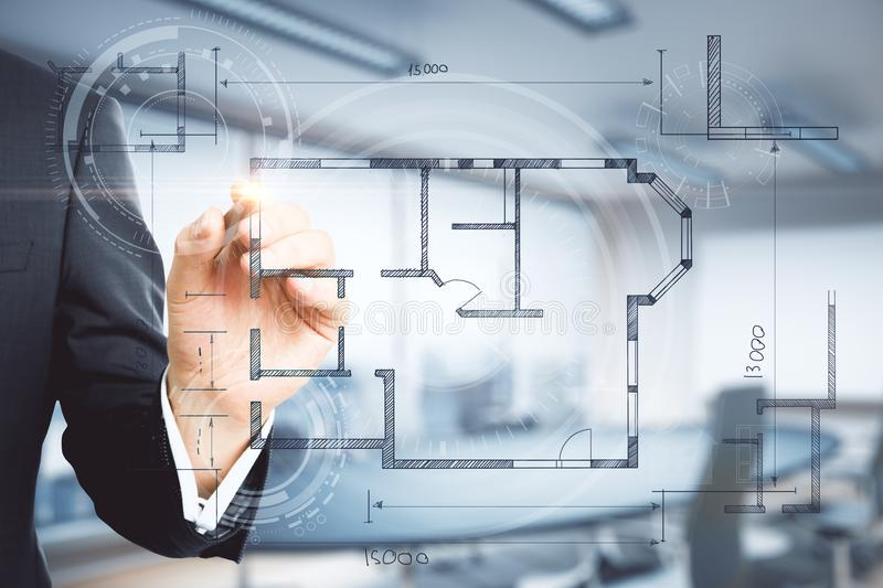 Real estate and engineering concept. Hand drawing creative building plan on blurry interior background. Real estate and engineering concept. Double exposure royalty free stock photos