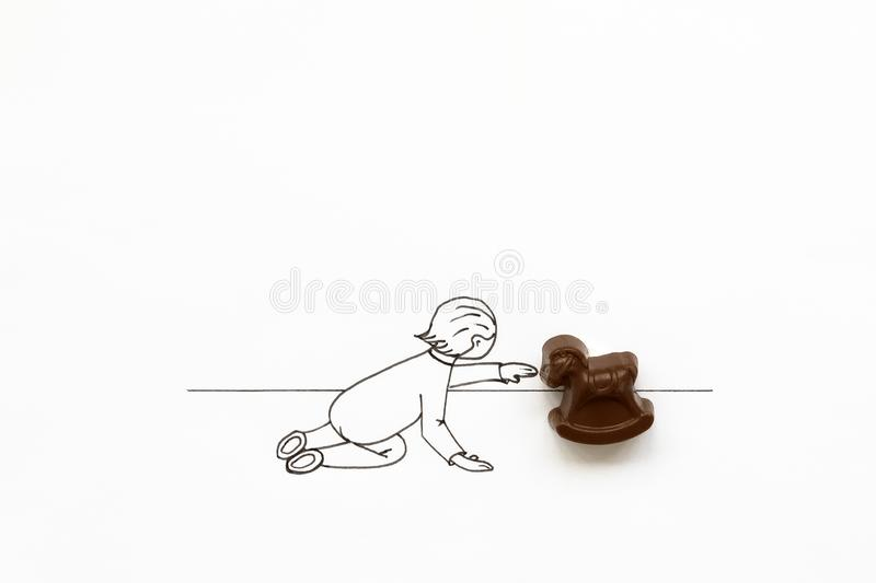 Hand drawing cute cartoon baby playing with toy rocking horse. Minimal, creative or food art concept. Copy space.  stock illustration
