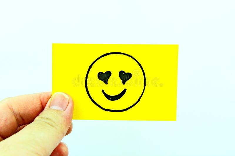 Hand drawing emoji with emoticon face stock photography