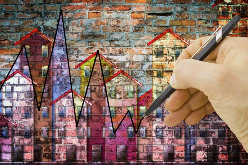Hand drawing a graph about real estate market trends - concept image stock image