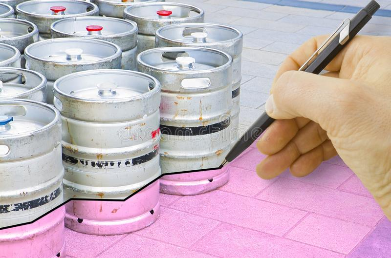 Hand drawing a graph about the trend of beer production with kegs of beer on background.  royalty free stock photo
