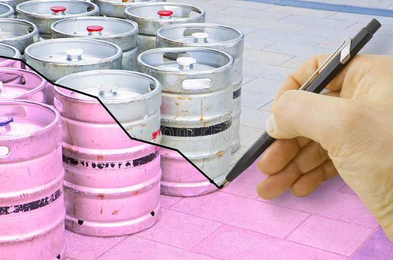 Hand drawing a graph about the trend of beer production with kegs of beer on background.  royalty free stock photography
