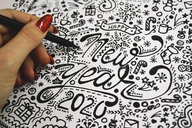 hand drawing happy new year 2020 xmas christmas art black and white painting doodle design details on the paper drawn by girl stock photography