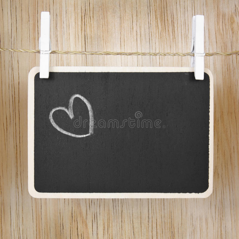 Hand drawing heart on blackboard. In wood case stock photo