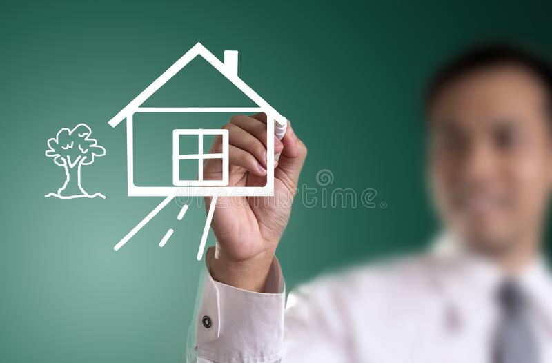 hand drawing house in a whiteboard royalty free stock photos