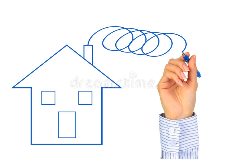 Hand is drawing new house. stock photo