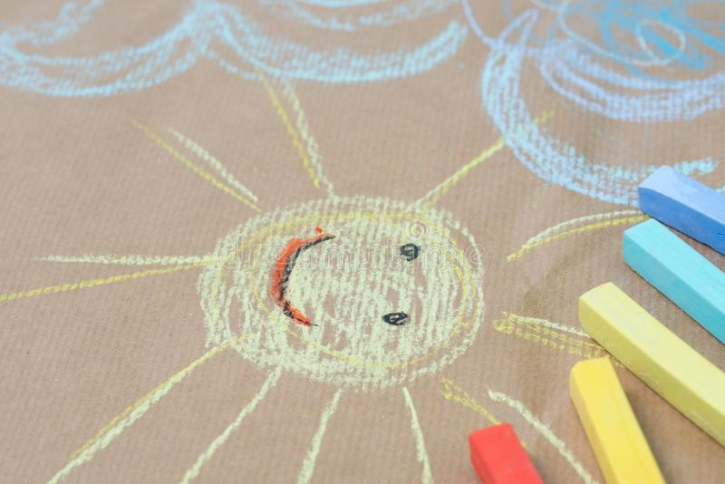 Hand drawing on recycled paper - sun and clouds royalty free stock image