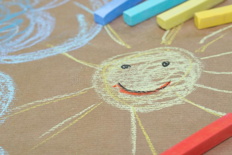 Hand drawing on recycled paper - sun and clouds stock images