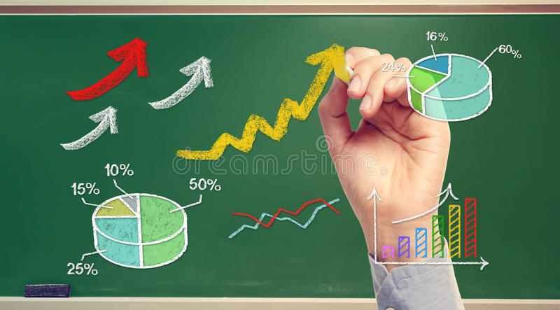 Hand drawing rising arrows and graphs on chalk board stock illustration