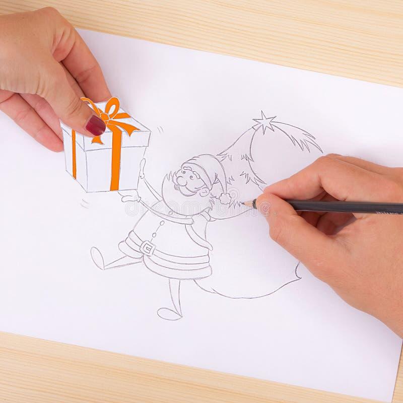 Hand drawing santa and santa giving gift royalty free stock photo
