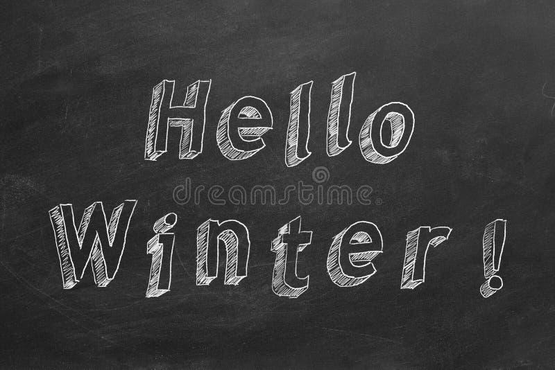 Hello Winter. Hand drawing text `Hello Winter` on blackboard royalty free stock photos