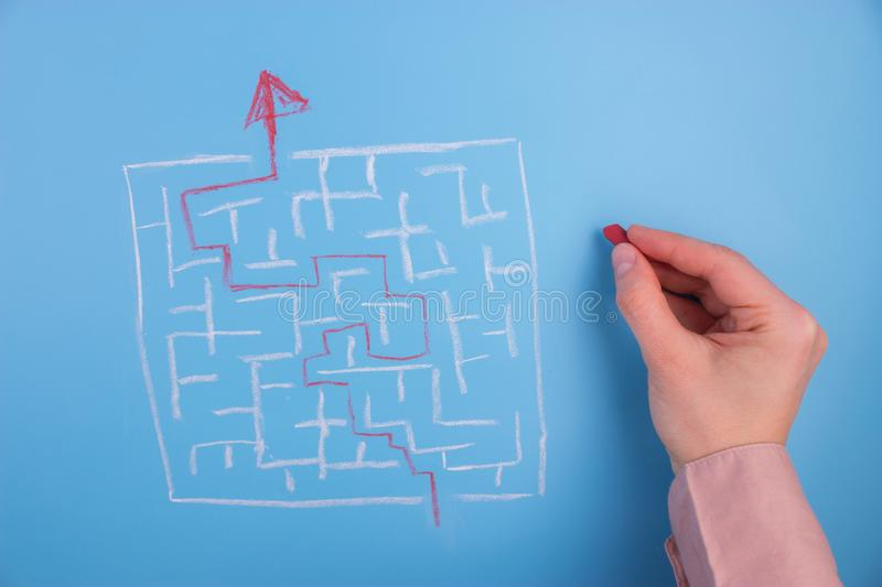Hand drawing to a maze royalty free stock image