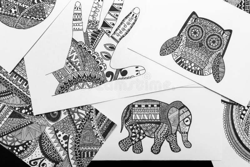 Hand drawn black and white doodle sketches, coloring mandala pages. Manila, Philippines - August, 18, 2016: Hand drawn black and white doodle sketches, coloring royalty free stock image