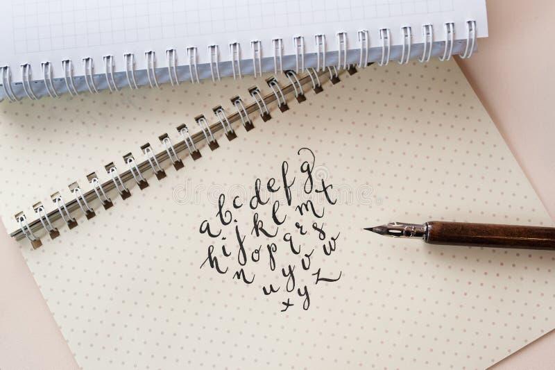 Hand drawn calligraphic English alphabet written with ink pen.  stock photos