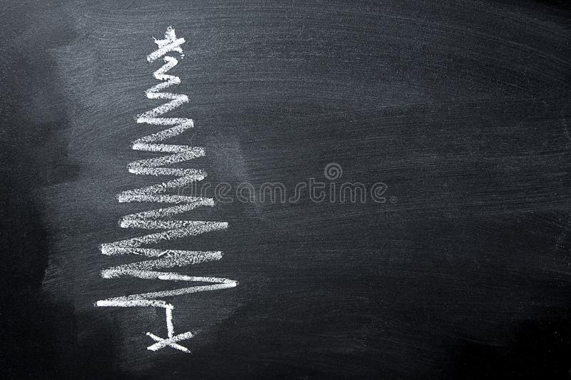 Hand Drawn Doodle Christmas Tree Chalk Blackboard in Spiral Form. New Year Greeting Card Poster Banner stock photo