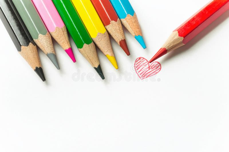 Hand drawn doodle red heart row of multicolored pencils on white paper background. Valentine Mother`s Day family. Kids charity romantic love concept. Greeting stock images