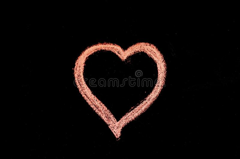 Hand drawn heart on chalk board.  stock photos
