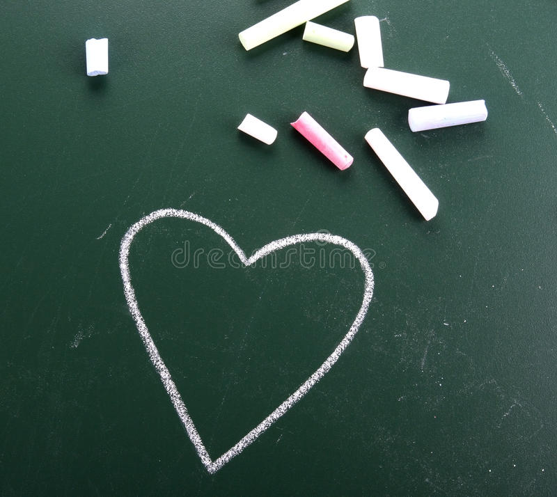 Hand drawn Heart. With chalk on drawing desk royalty free stock images