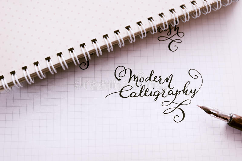 Hand drawn lettering background. Lettering brush calligraphy on paper.  royalty free stock image