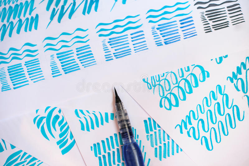 Hand drawn lettering background. waterbrush calligraphy on paper.  royalty free stock photos