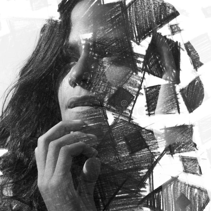 Paintography. Double Exposure charcoal drawing combined with portrait of a woman with strong features and expression, black and w stock images