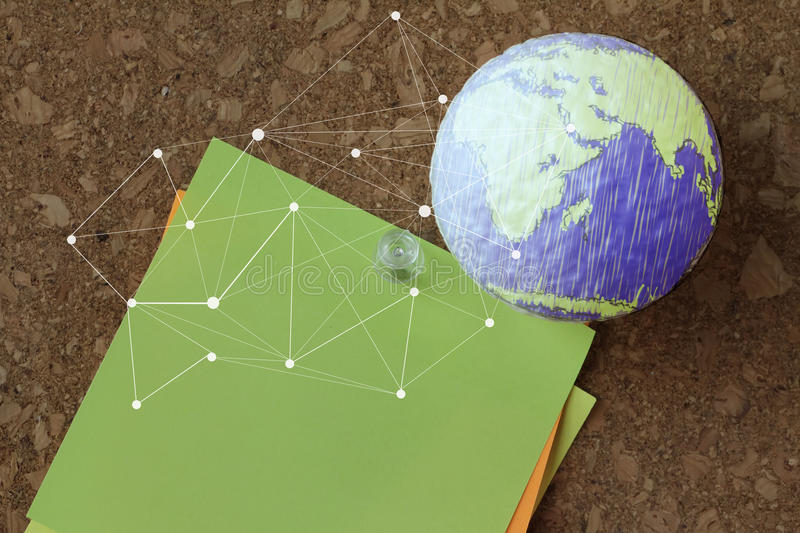 Hand drawn texture globe with pin and business graph. On sticky note on cork board as concept stock images
