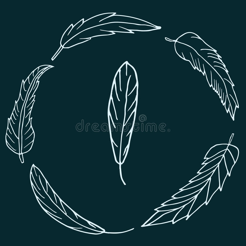 Hand drawn wreath of feathers on dark green background royalty free stock photo