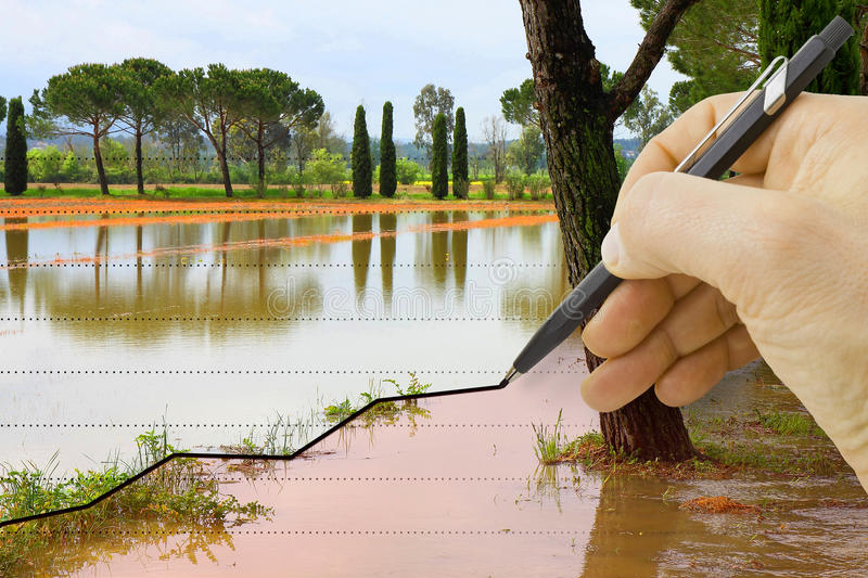 Hand draws a graph about seasonal rainfall - concept image royalty free stock image
