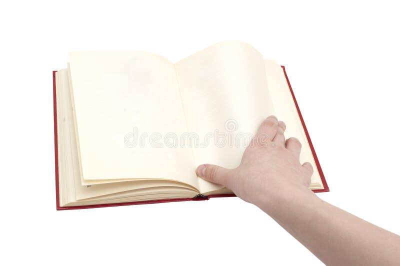 Hand drehen eine Seite um stockbilder