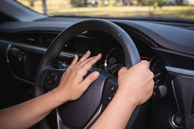 Hand of driver on steering royalty free stock images