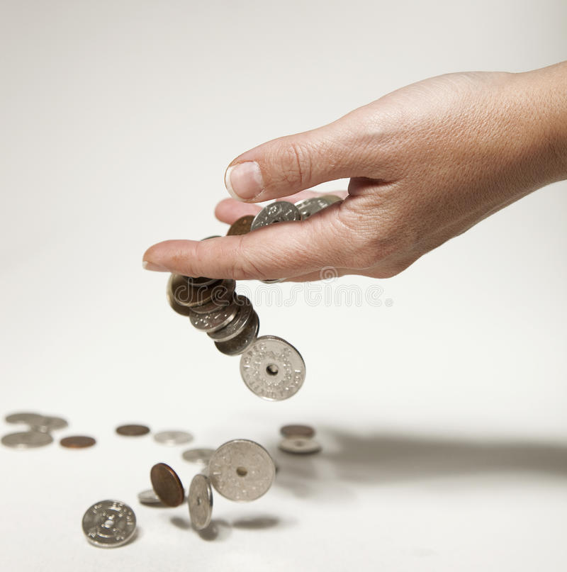 Free Hand Dropping Norwegian Coins Royalty Free Stock Photo - 22022315